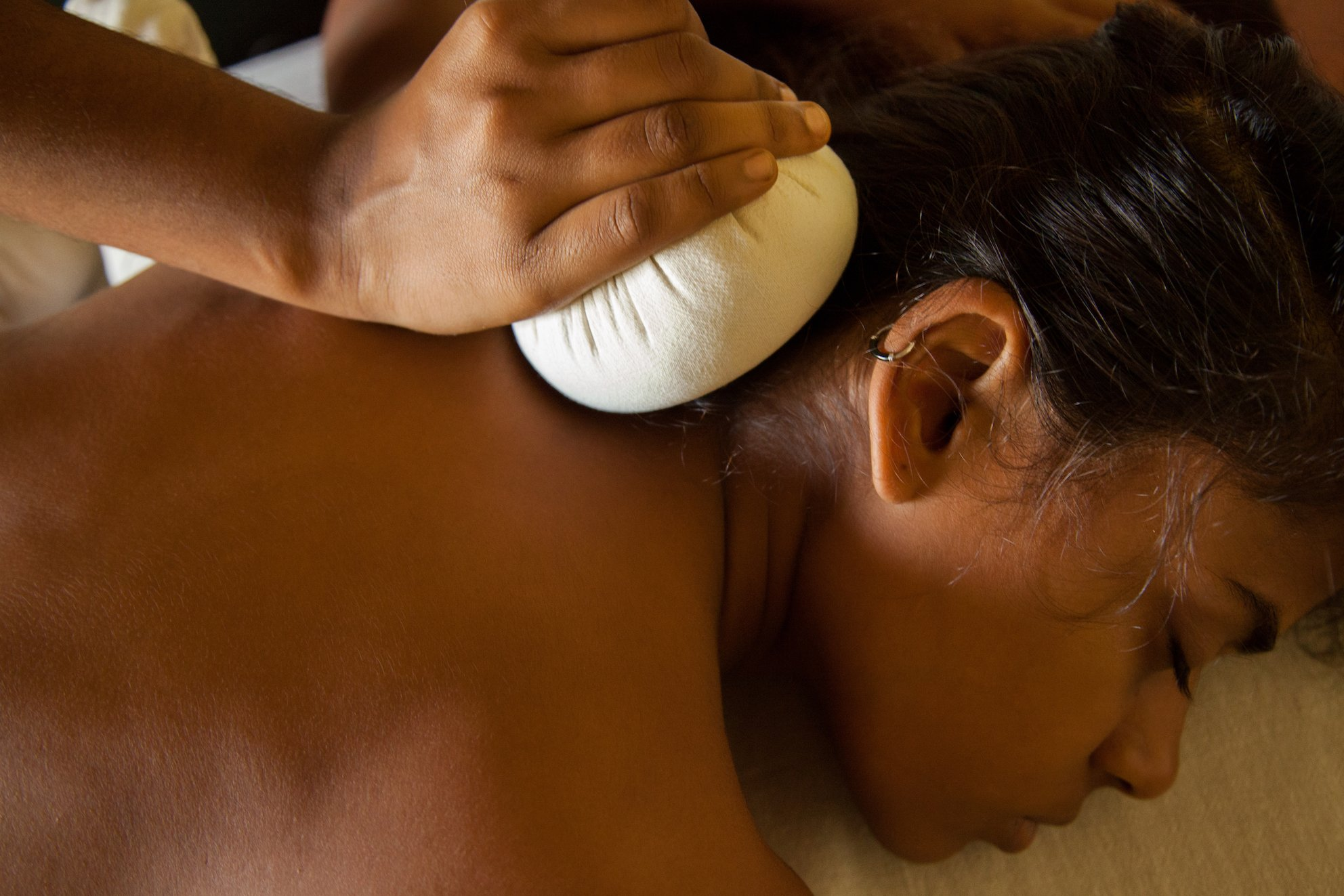 Relax during a massage with herbal essences in an Ayurvedic treatment at SwaSwara.